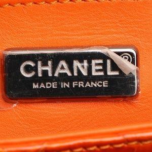 CHANEL Bags - CHANEL SMALL ORANGE PYTHON FLAP